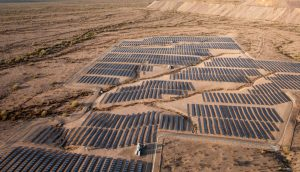 Aerial View of Solar Trackers in Desert