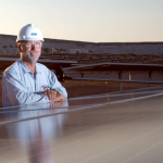Array Tech Engineer Standing With Solar Panels